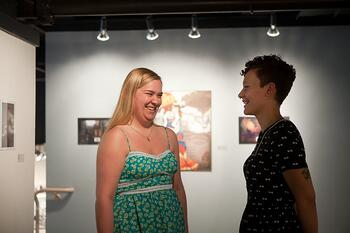 students chatting in gallery