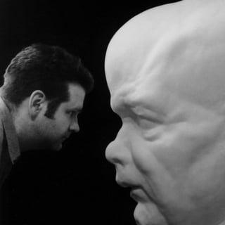 Jeff_Hesser_HeadShotWithSculpture.jpg